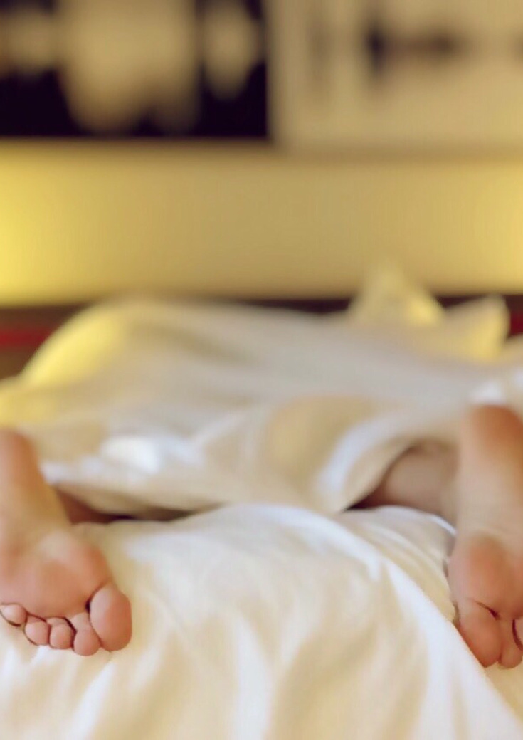 Feet outside cover on mattress