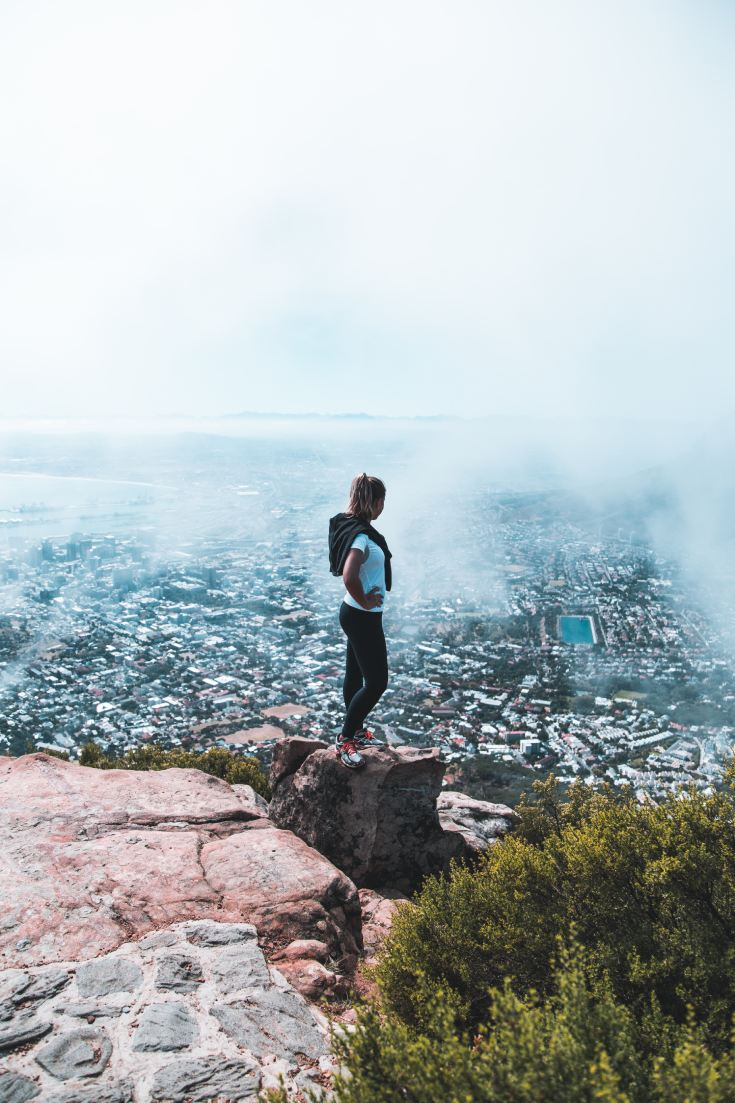 Woman hiking at top of mountain