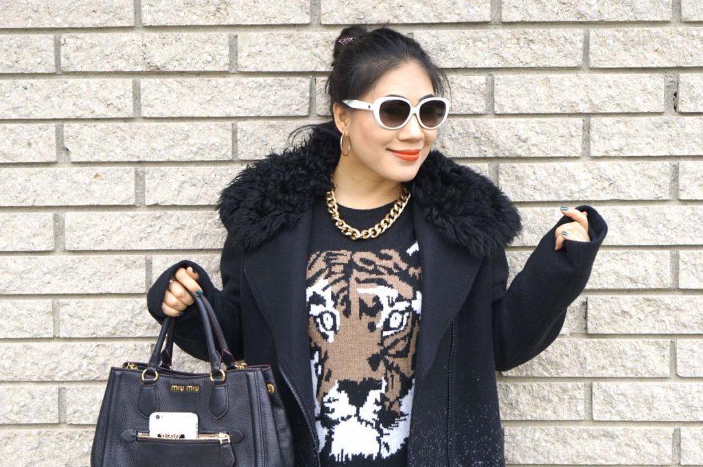grace-in-a-tiger-sweater-with-a-miu-miu-purse