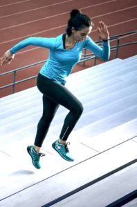 Woman exercising on the stairs
