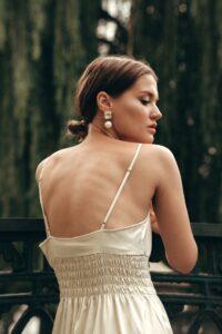 Girl wearing slip dress and pearl earrings