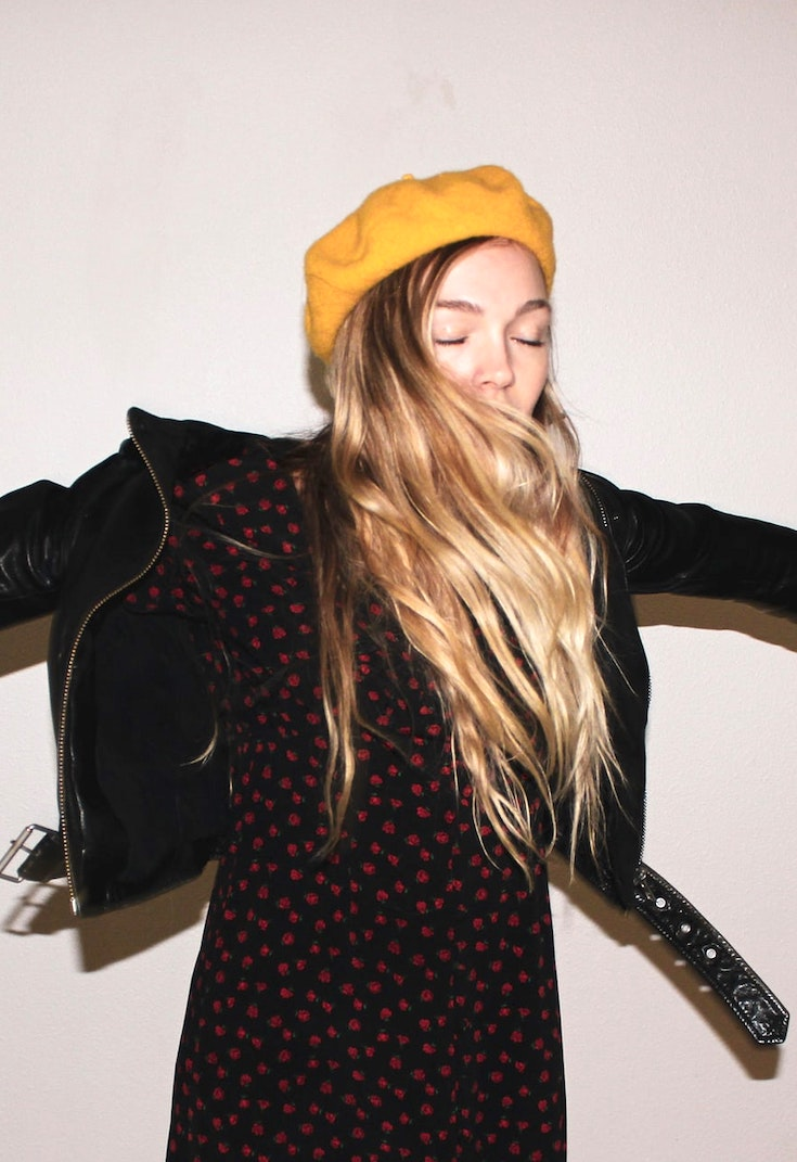 Girl wearing yellow beret and leather jacket
