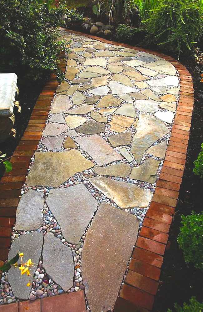 Flagstone pathway with brick in backyard