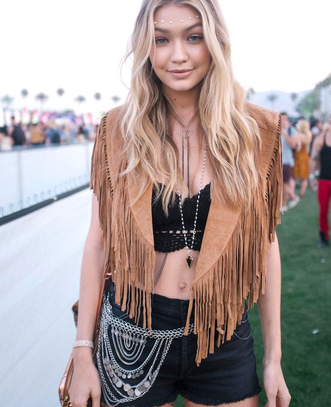 Gigi Haddid fringe vest and black outfit, Coachella fashion