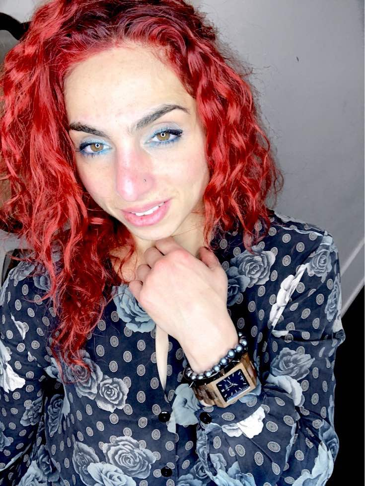 Red curly mid length style of hair