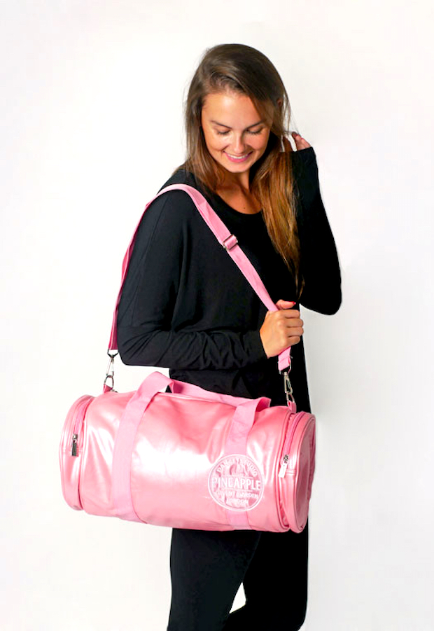 Woman holding pink dancer bags