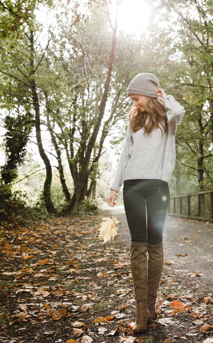 Woman wearing jeans and sweater with boots look