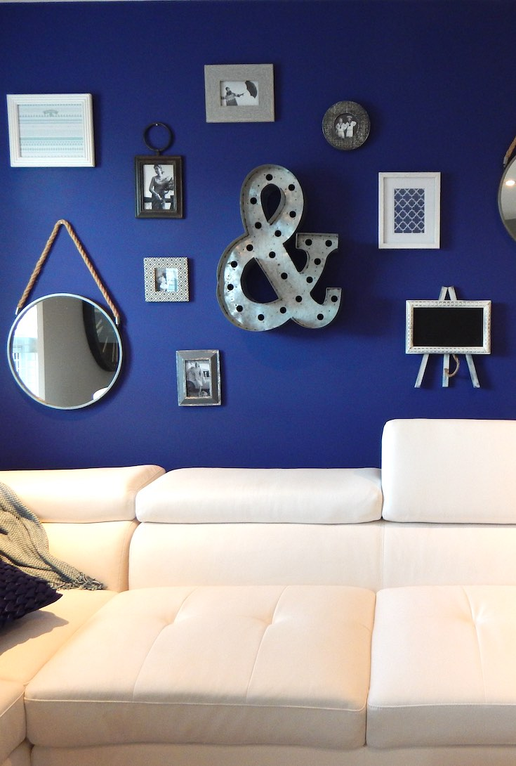 White sectional with navy walls