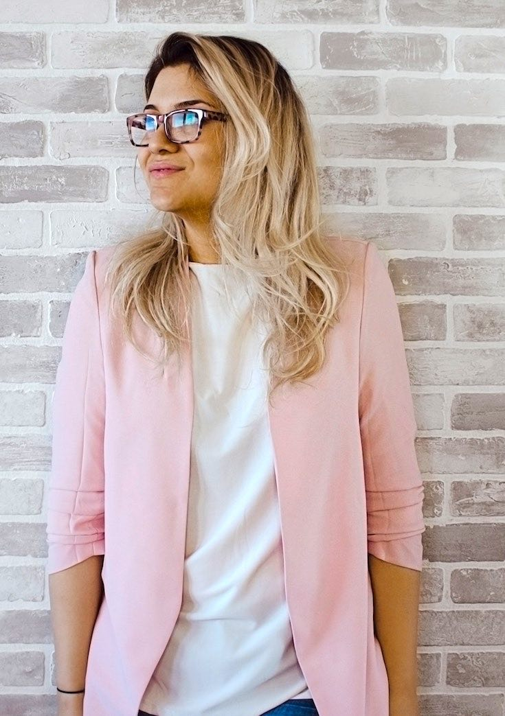 Woman in pink blazer and white shirt
