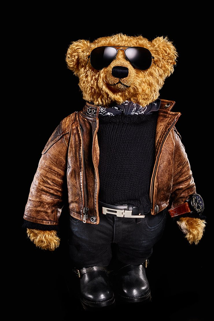 Ralph Lauren bear in leather coat, jeans, black boots and watch