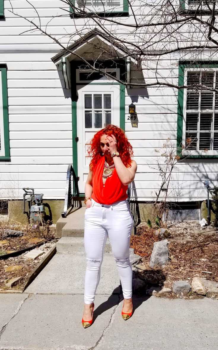 White high waisted jeans and orange top