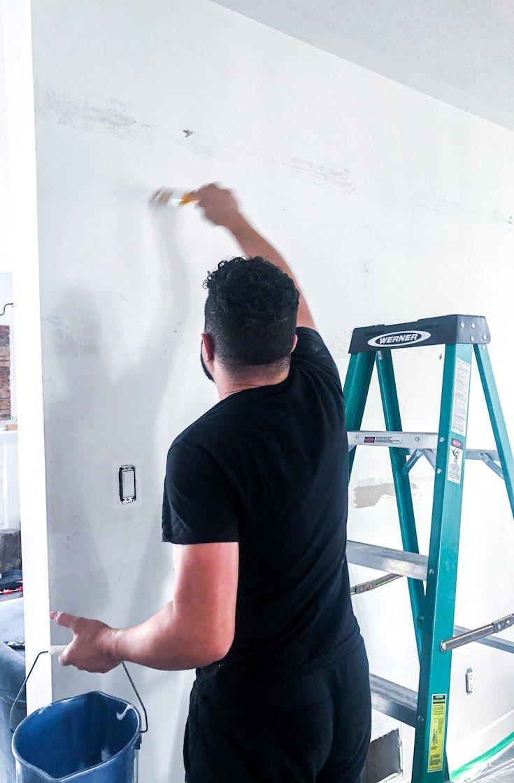 Applying glue on wall