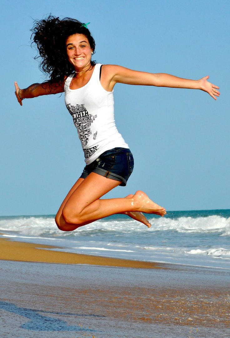 Best health routine, woman jumping in the air at the beach_pin