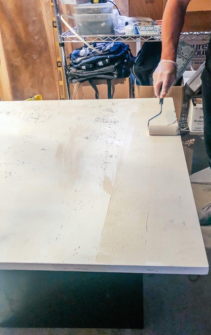Applying base coat on table surface