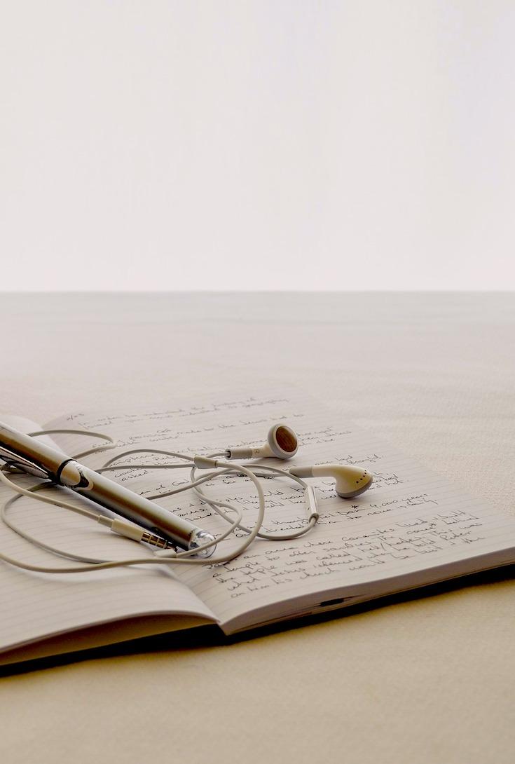 Journal writing, earphones