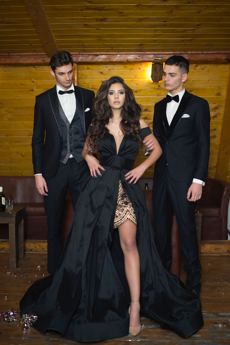 Prom black and gold gown with date in tux
