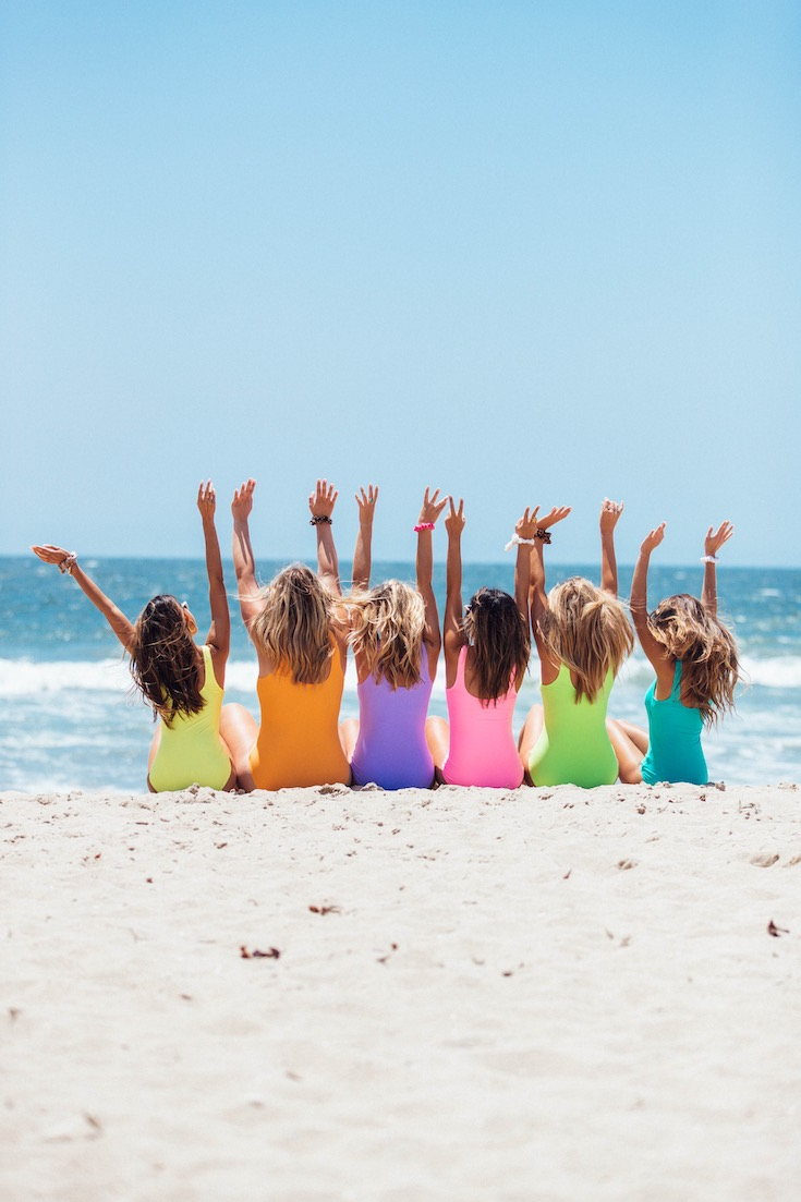 Back view of girls on a beach