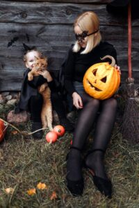 Mom and daughter in costumes, Halloween things to do