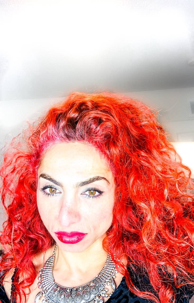 Red curly hair colour tube and developer