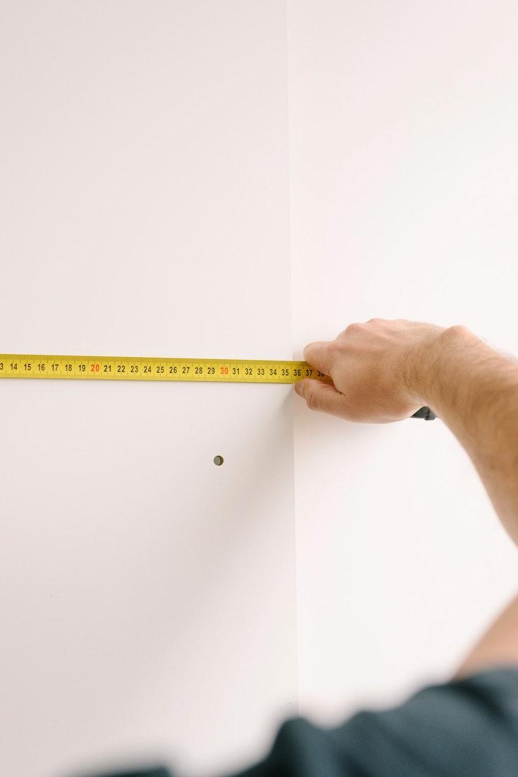 Person measuring walls