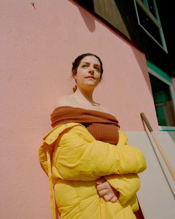 Celine Semaan Vernon in orange dress and yellow coat