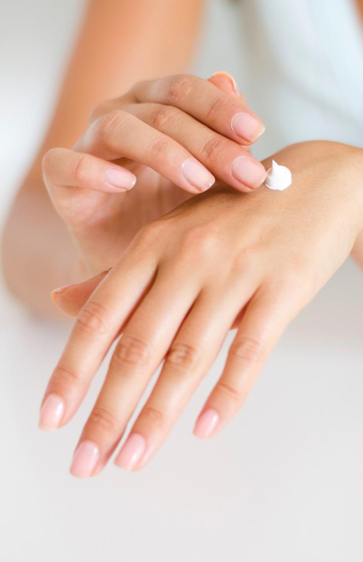 Woman applying lotion, skincare routine