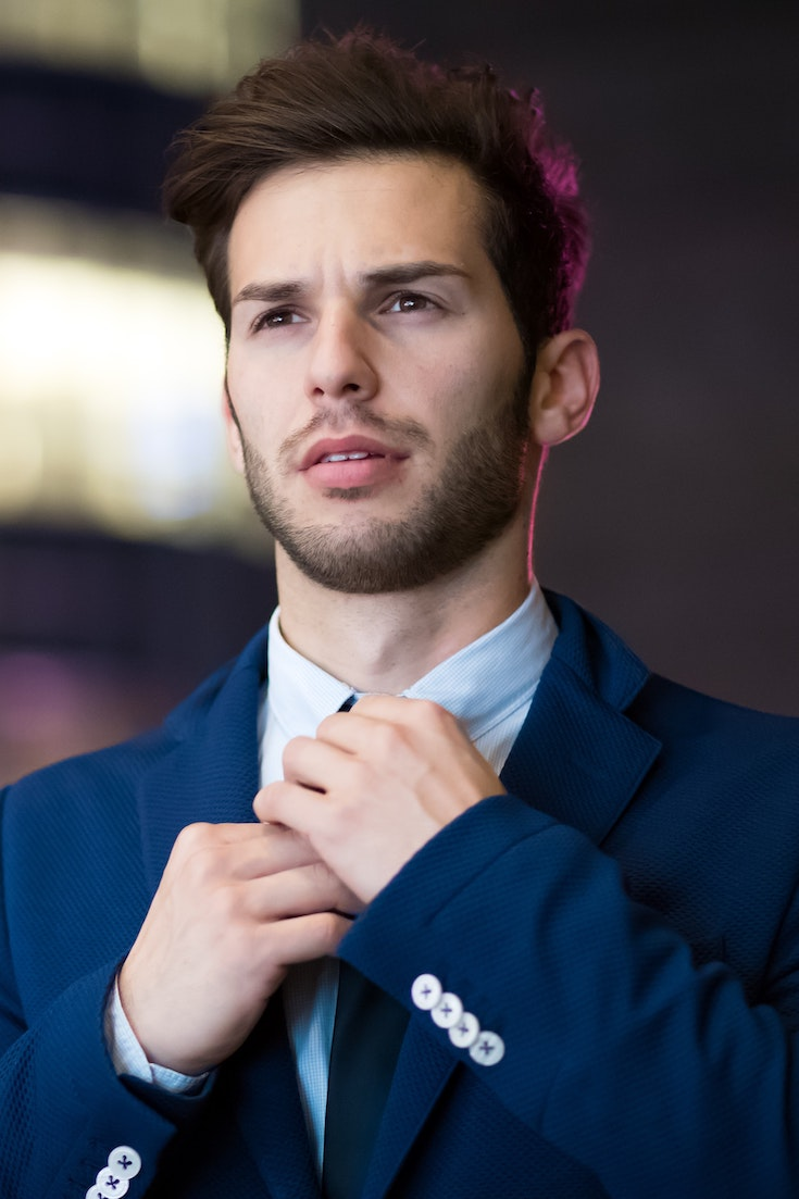 Man in blue suit, hair loss treatment