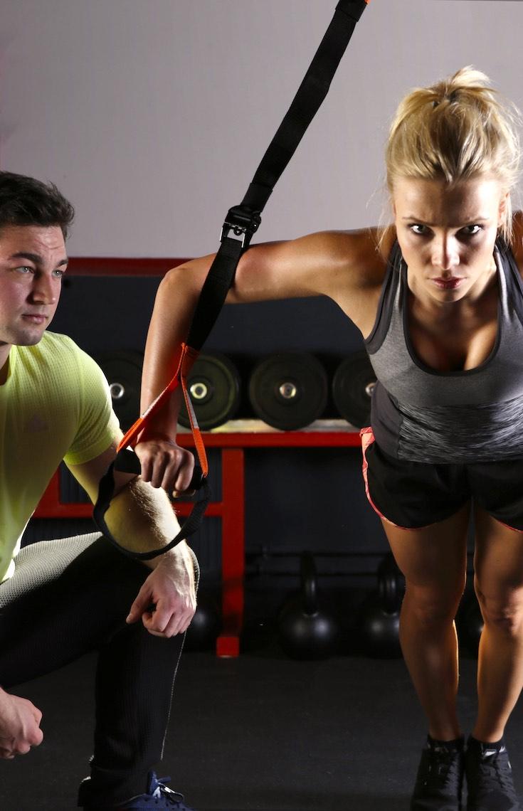 Fitness trainer, girl TRX