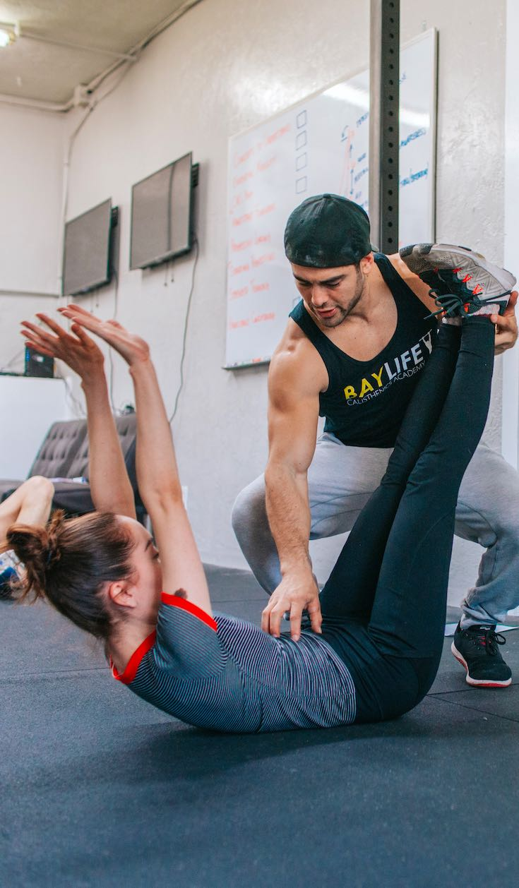 Personal trainer stretching client