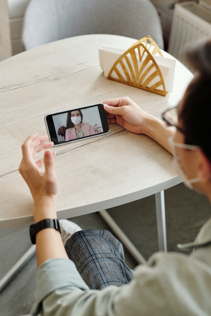 Man-having-a-video-call-on-his-phone