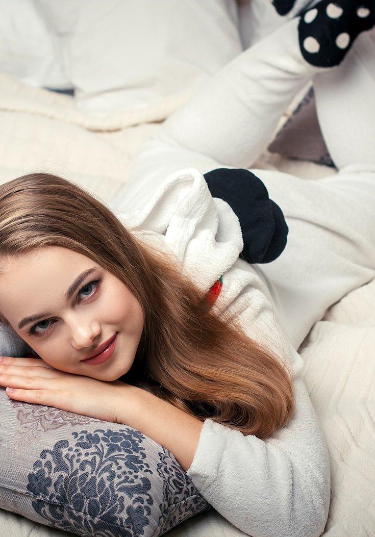 Girl lying on bed wearing pyjamas