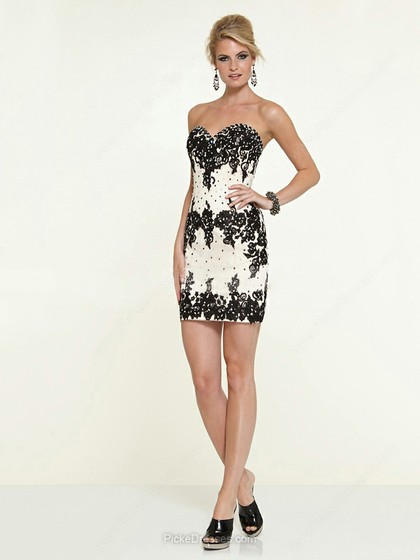 Embroidered short black and white dress with beading