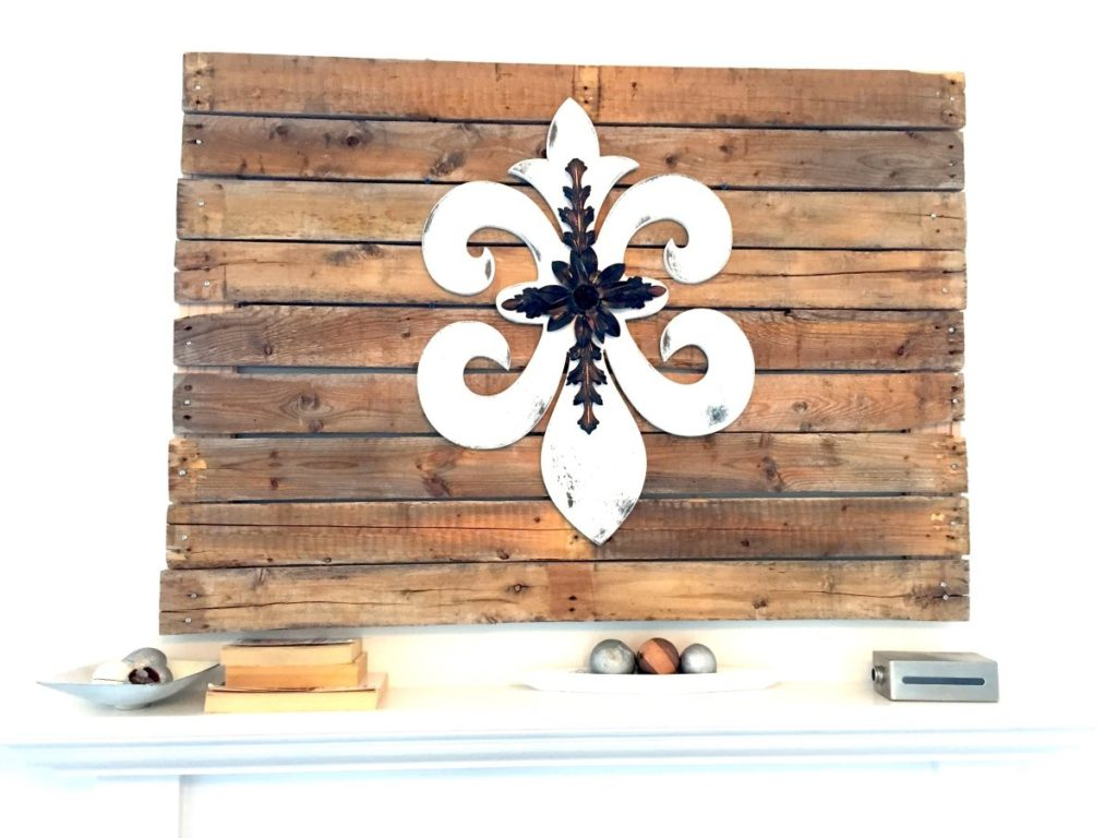 DIY pallet wall art above mantle