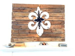 DIY pallet wall art above mantle
