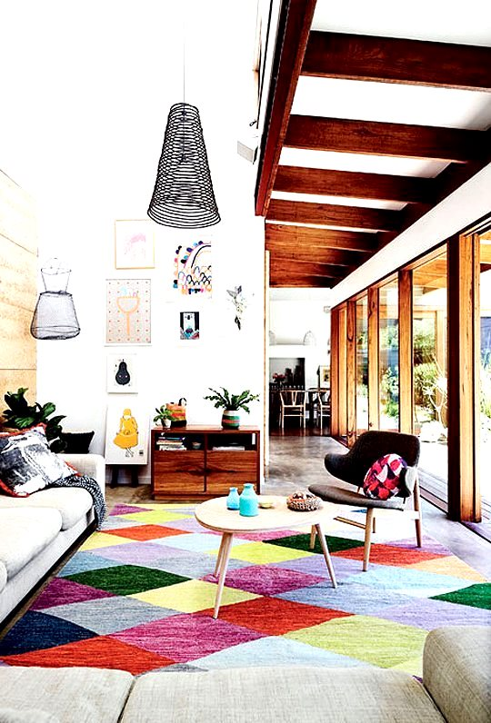 Living room with bold rug and accents