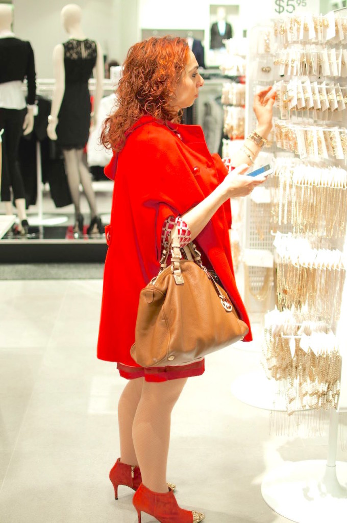 Red cape and red dress selecting jewellery