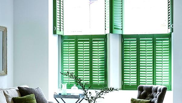 Tier on tier green window shutters