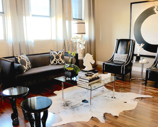 Contemporary living room with cowhide rugs
