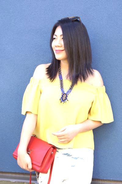 Grace's outfit - yellow top, red bag