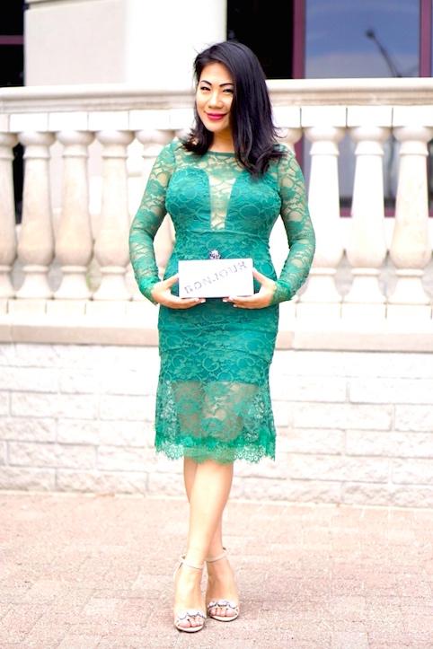 Grace in a green lace dress