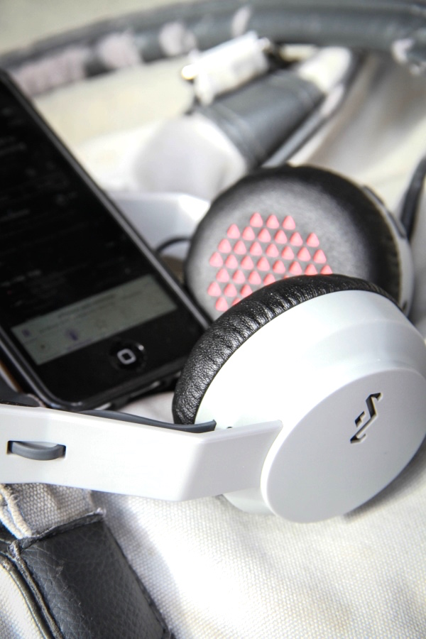 House of Marley Rebel headphones plugged into phone