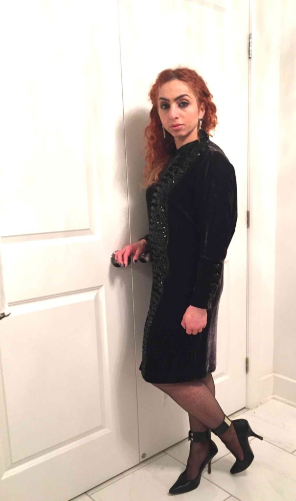 Rania in velvet vintage dress with fishnet stockings and ankle strap shoes
