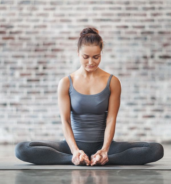 Woman doing yoga, yoga exercise, yoga to relieve stress