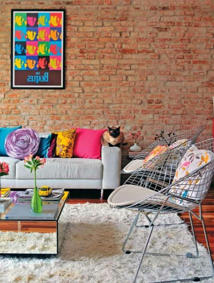 Brick wall with pop art decor in living-room