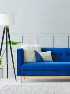 Living room blue sofa and floor lamp
