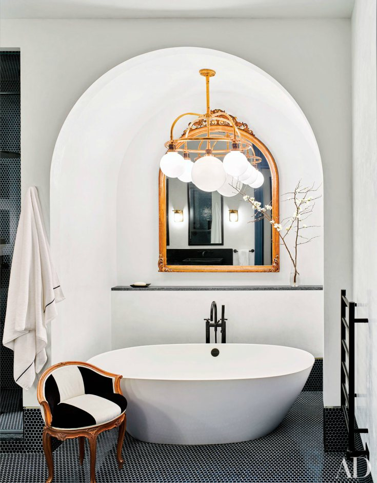 White and black bathroom interior and starburst ceiling light
