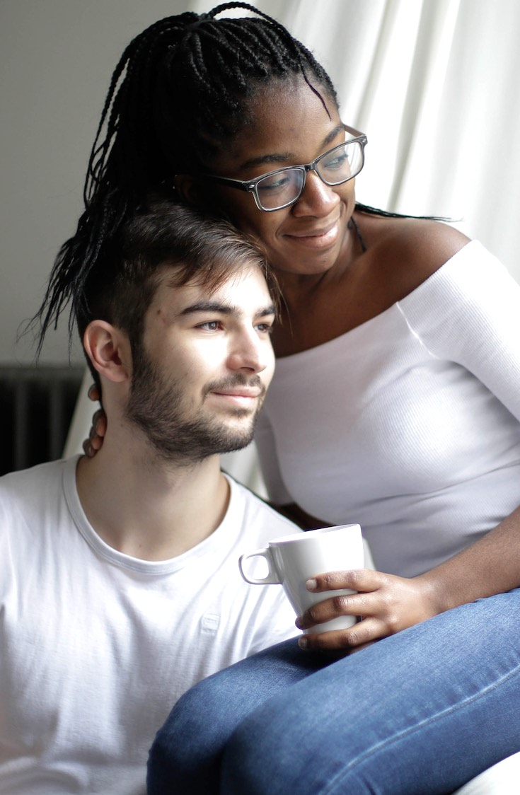Multiethnic couple resting together