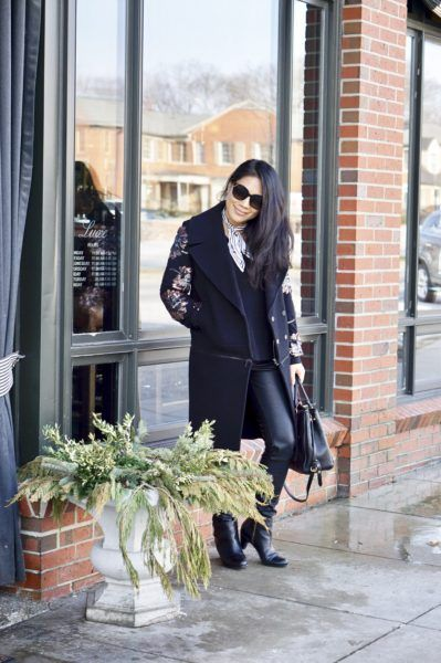 Black jacket with leather sleeves and black pants