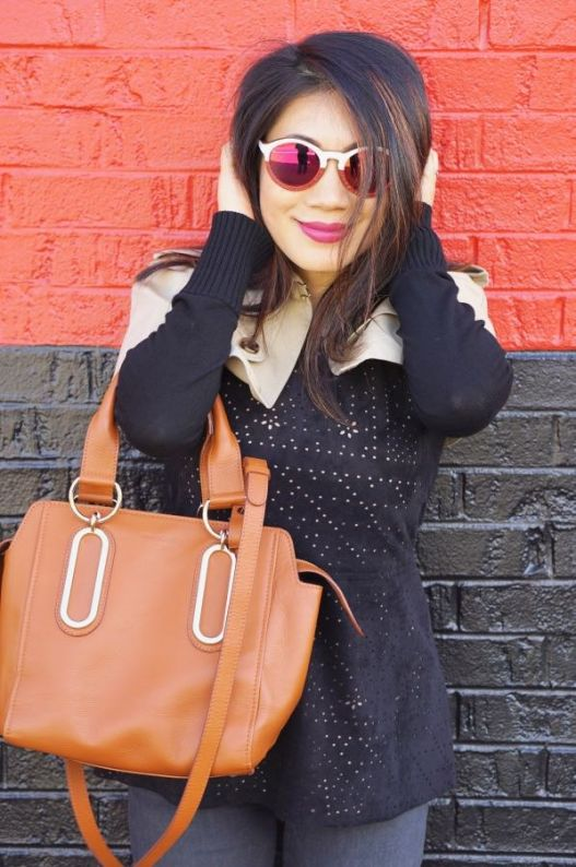 Black and beige top with caramel bag and grey jeans