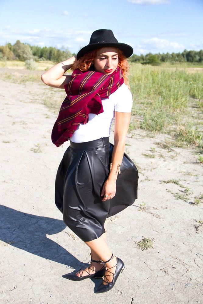 Black leather skirt, white top, black hat, wrap ballerina flats and blanket scarf